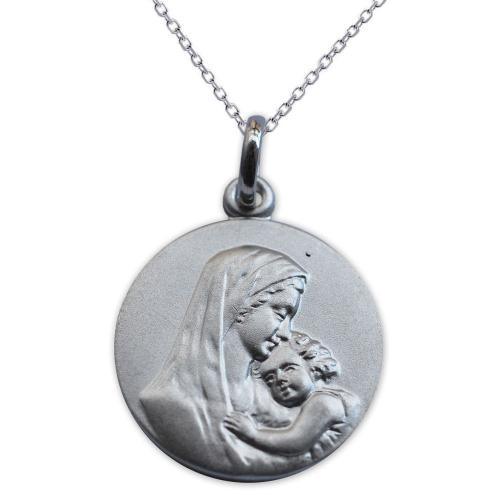 Medalla de la Virgen y el Niño en plata maciza grabada