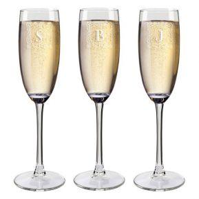 Copa de champaña con iniciales